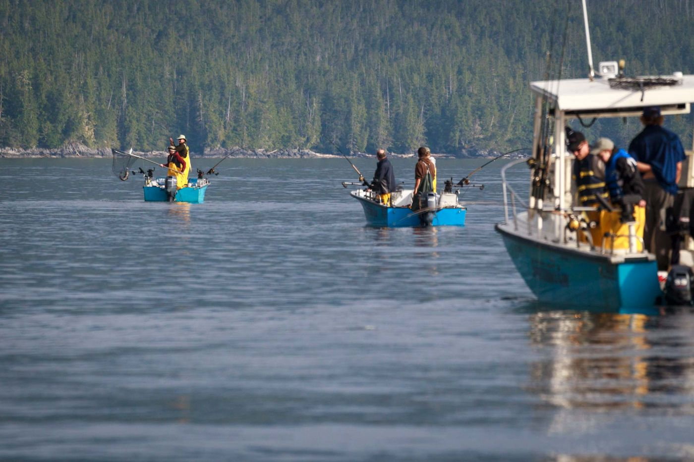 3 fishing boats each filled with guests of Rivers Inlet Sportsman's Club fishing lodge head out to the fishing grounds eager for a day of catching salmon
