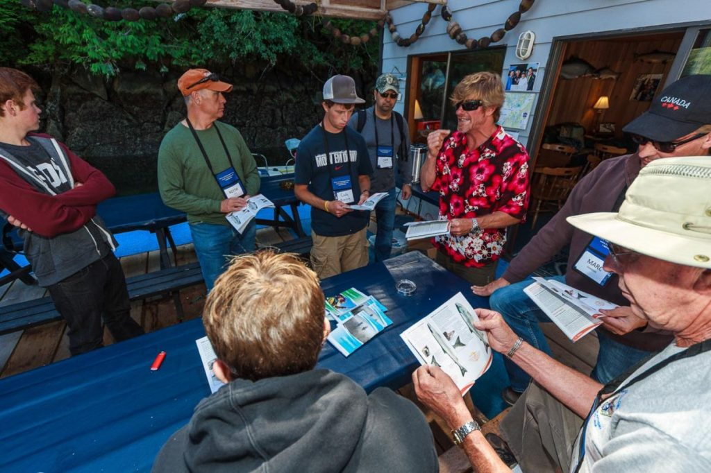 Rivers Inlet Sportsman's Club owner Simon is hosting one of his daily fishing seminars where all guests attend, watch and learn