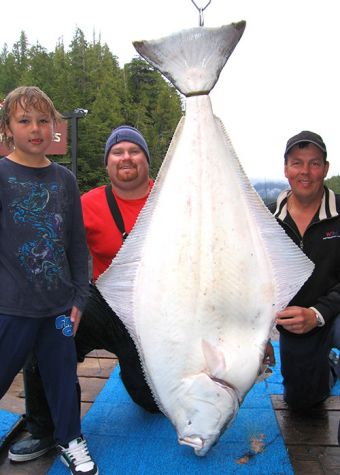 Andy & son Alex Sarglepp 115 lbs. with guide Scottydawg. The halibut outweighed 'the kid' by over 45 lbs.
